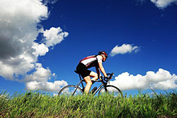 cyclist blue sky